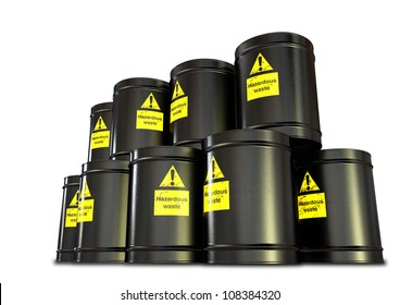 A stack of black metal barrels with yellow hazardous waste labels on each
