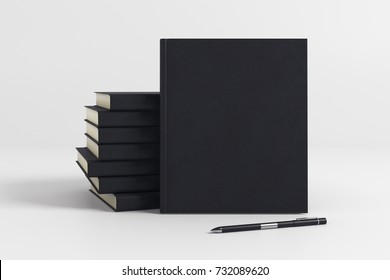 Stack of blank black hardcover organizers on light background. Supplies concept. Mock up, 3D Rendering