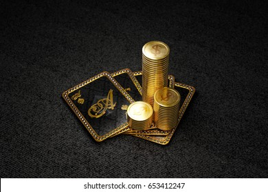 Stack of gold coins on royal poker cards on ace of spades. 3D illustration on black background, top view.