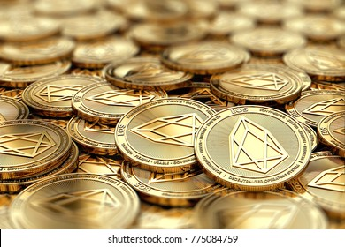 Stack of golden EOS coins in blurry closeup with copy space above in blurred area. 3D rendering