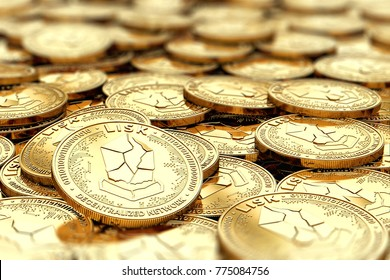 Stack of golden LISK coins in blurry closeup with copy space above in blurred area. 3D rendering