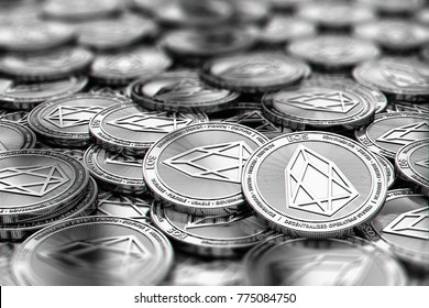 Stack of silver EOS coins in blurry closeup with copy space above in blurred area. 3D rendering