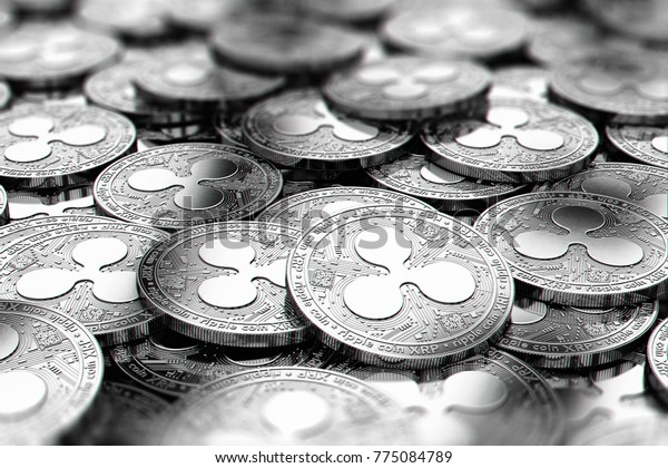 Stack of silver Ripple XRP coins in blurry closeup with copy space above in blurred area. 3D rendering