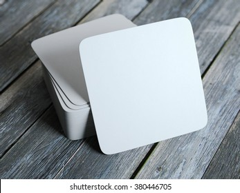 Stack of white square beer coasters