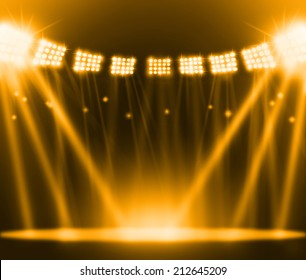 stage spot lighting over gold background.