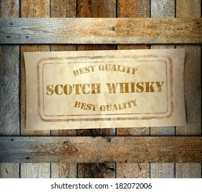 Stamp Best Quality Scotch Whisky label on old wooden box