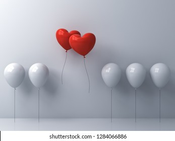 Stand out from the crowd and different creative idea Two red heart shape balloons flying away together from white balloons on white wall background Love couple concept for valentine's day 3D rendering