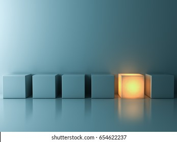 Stand out from the crowd and different creative idea concepts , One glowing cube standing among green cubes on green background in the row with reflections and shadows . 3D rendering.