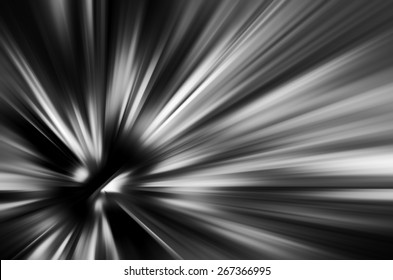 Starburst with radial blur in black and white, for motifs of origin, expansion, or contraction in decoration and backgrounds