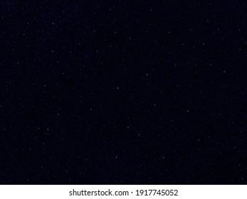 Starry night sky dark deep blue galaxy space background. 3D photo.