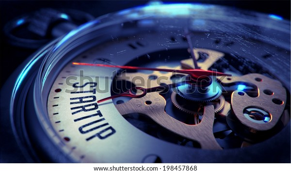 Startup on Pocket Watch Face with Close View of Watch Mechanism. Time Concept. Vintage Effect.
