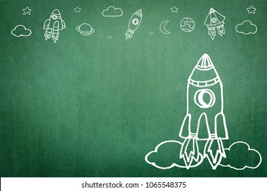 Startup rocket for business start-up project, entrepreneur innovation concept with creative launching spaceship imagination doodle motivation drawing on office or school class teacher's chalkboard