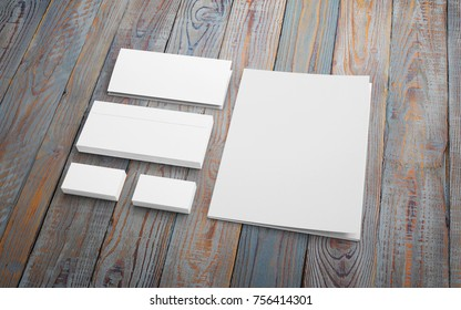 Stationery set on wooden desk. Blank envelopes, folder and cards to showcase your presentation.