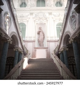 Statue of a female in a courtyard with stairs..Photo realistic 3d rendered illustration