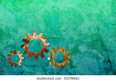 Steampunk background with gear icons on a turquoise grunge texture