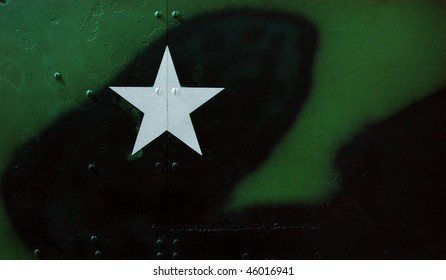 Steel or metal texture with camouflage and white star