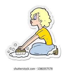 sticker of a cartoon woman scrubbing floor