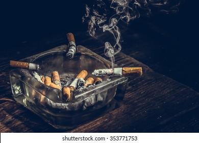 Still life cigarette and glass ashtray. Some man like smoking in work time for make idea.
