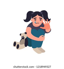 Stop violence and abused children. Little girl is sitting on the floor and crying. Unhappy childhood concept. Childrens traumatic experience. Misbehavior of parents.