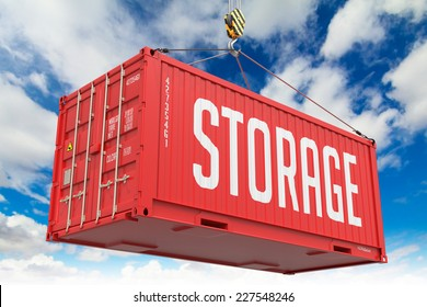 Storage - Red Hanging Cargo Container on Sky Background.