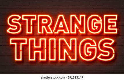 Strange things neon sign on brick wall background