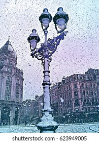 Street lamp in retro vintage style in downtown of the old European city and winter snowfall. Lille, France.   Vertical colored engraving Illustration.