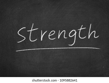 strength concept word on a blackboard background