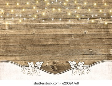 string of lights glowing on rustic wood with textured border