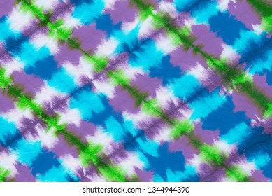 striped tie dye pattern hand dyed on cotton fabric abstract background.