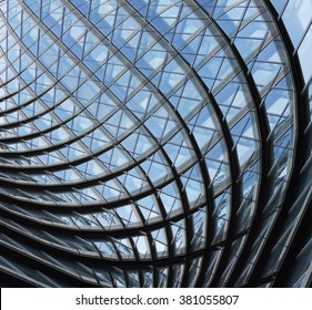 Structural glass facade of fantastic office building. Contemporary architectural fiction. Glazed aluminum structure. Abstract architecture fragment.