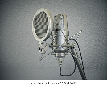 studio microphone isolated on a grey  background
