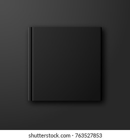 Stylish black book mockup on dark black background. Blank black photobook album cover front page template with copyspace for your design.