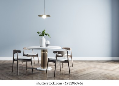 Stylish dining room interior design with modern white table, wooden chairs around a parquet. 3D rendering