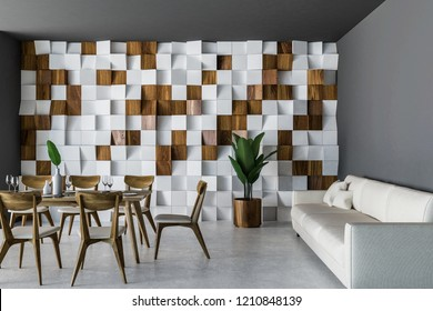 Stylish dining room interior with wooden tiled wall, concrete floor, long wooden table with chairs and long white sofa. 3d rendering