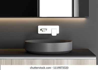 Stylish gray sink standing on a wooden countertop attached to a gray wall. A long horizontal mirror hanging above it. 3d rendering mock up
