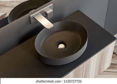 Stylish gray sink standing on a wooden countertop attached to a gray wall. A long horizontal mirror hanging above it. A top view. 3d rendering mock up