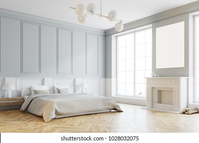 Stylish master bedroom corner with gray and white walls, a gray bed and a fireplace with a poster above it. 3d rendering mock up