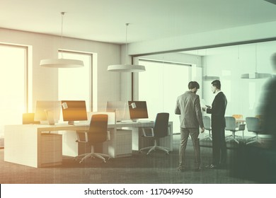 Stylish office interior with white walls, carpet on the floor, loft windows and rows of computer tables with blue chairs. Business people 3d rendering mock up toned image double exposure blurred