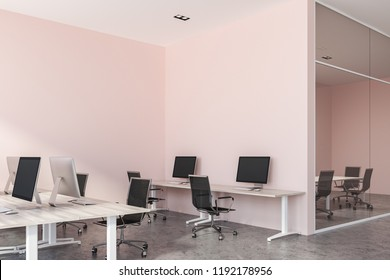 Stylish pink wall office interior with wooden desks with computers and concrete floor. Glass wall meeting room in the background. 3d rendering copy space