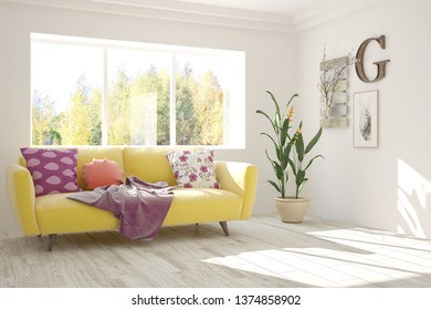 Stylish room in white color with sofa and autumn landscape in window. Scandinavian interior design. 3D illustration