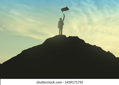 Success Concept, Silhouette of young men and flag are celebrating success on top of hill, sky and sun light background. Business, successful, leadership, achievement, and goal concept.