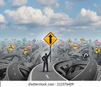 Success direction with a confident businessman standing on a group of tangled streets holding up a traffic sign with an upward arrow as a symbol for clear belief and conviction to a prosperity path.