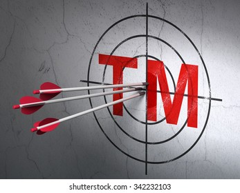 Success law concept: arrows hitting the center of Red Trademark target on wall background