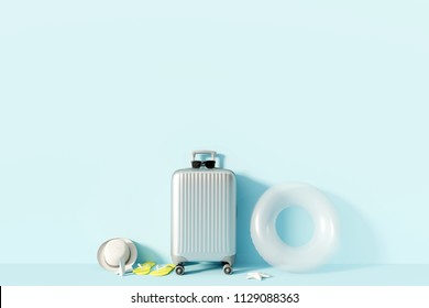 Suitcase and beach accessories with sunlight on pastel blue background. summer travel concept. 3d render
