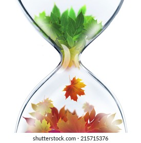 From summer to autumn.The changing seasons concept with hourglass
