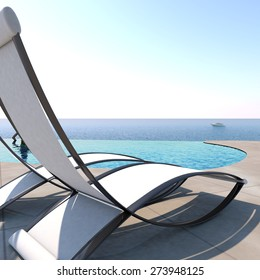 Sun loungers inviting to relaxation and rest near to an infinity pool with panoramic sea view to enjoy life.