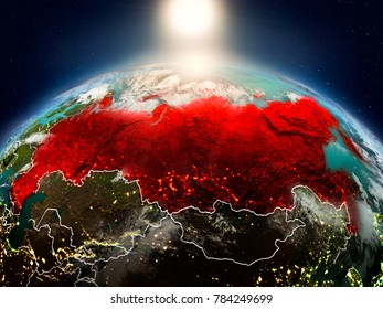 Sunrise above Russia highlighted in red on model of planet Earth in space with visible country borders. 3D illustration. Elements of this image furnished by NASA.