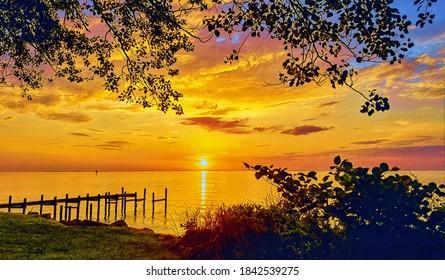 Sunrise, Chesapeake Bay, fishing pier and foliage