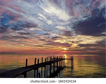 Sunrise, Chesapeake Bay, waves and fishing pier, illustration