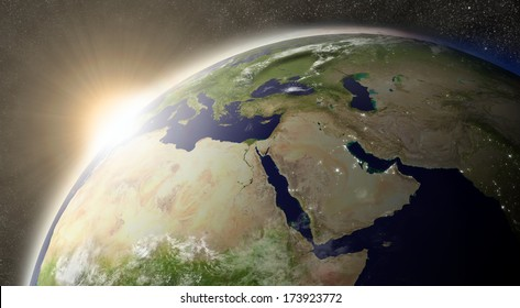 Sunset over Middle East region on planet Earth viewed from space with Moon and stars in the background. Elements of this image furnished by NASA.